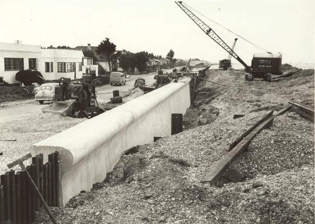 s_east-beach-estate-flood-wall-may-1954